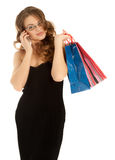 Woman with shopping bags calling by phone Stock Photography