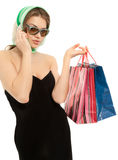 Woman with shopping bags calling by phone Stock Photo