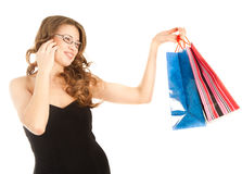 Woman with shopping bags calling by phone Royalty Free Stock Photo