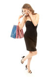 Woman with shopping bags calling by phone Royalty Free Stock Image