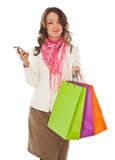 Woman with shopping bags calling by phone Stock Image