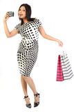 Woman with shopping bags and camera Royalty Free Stock Photo