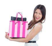 Woman with shopping bags cheerful smiling and winking Royalty Free Stock Photos