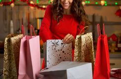 Woman with shopping bags in christmas decorated ki Stock Photos