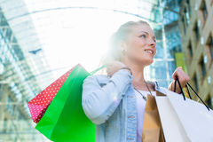 Woman shopping with bags in city Royalty Free Stock Images