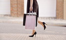 Woman with shopping bags in the city Stock Photos