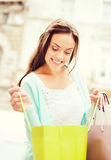 Woman with shopping bags in city Royalty Free Stock Photography