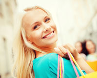 Woman with shopping bags in city Stock Photos