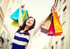 Woman with shopping bags in city Stock Image