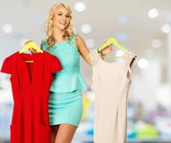 Woman with shopping bags in clothing store Stock Photo