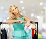 Woman with shopping bags in clothing store Royalty Free Stock Images
