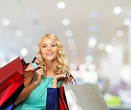Woman with shopping bags in clothing store Stock Photos