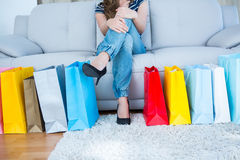 Woman with shopping bags on couch Royalty Free Stock Photo