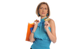Woman with shopping bags and credit card Royalty Free Stock Images
