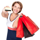 Woman with shopping  bags and credit card Stock Images
