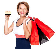 Woman with shopping  bags and credit card Royalty Free Stock Photos