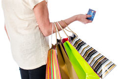 Woman with shopping bags and credit card Royalty Free Stock Image