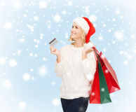 Woman with shopping bags and credit card Royalty Free Stock Photo