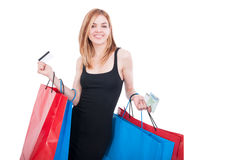 Woman with shopping bags and credit card. Smiling at the camera on white background with text space Royalty Free Stock Photo
