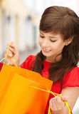 Woman with shopping bags in ctiy Stock Image