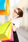Woman with shopping bags in ctiy Stock Images