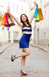 Woman with shopping bags in ctiy Royalty Free Stock Image