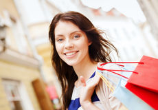 Woman with shopping bags in ctiy. Shopping and tourism concept - beautiful woman with shopping bags in ctiy stock images