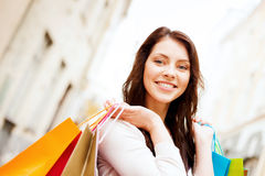 Woman with shopping bags in ctiy Stock Photo