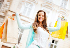 Woman with shopping bags in ctiy Royalty Free Stock Photos