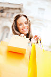 Woman with shopping bags in ctiy Royalty Free Stock Images