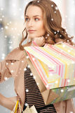 Woman with shopping bags in ctiy Royalty Free Stock Photography
