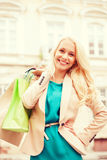 Woman with shopping bags in ctiy Stock Photography