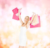 Woman with shopping bags in dress and high heels Royalty Free Stock Images