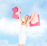 Woman with shopping bags in dress and high heels Stock Photography