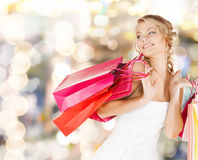 Woman with shopping bags in dress Royalty Free Stock Image