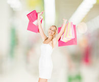 Woman with shopping bags in dress Royalty Free Stock Photos