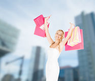 Woman with shopping bags in dress Stock Image