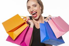 Woman with shopping bags - ecstatic, happy, dynamic girl royalty free stock photo