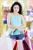 Woman with shopping bags in the fashion boutique Stock Photos