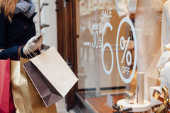 Woman with shopping bags in front on shop window Royalty Free Stock Images