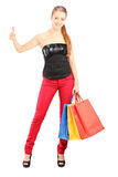 Woman with shopping bags giving thumb up Royalty Free Stock Photos