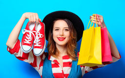 Woman with shopping bags and gumshoes Stock Image