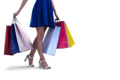 Woman with shopping bags in hand. Isolated on white background stock photos