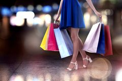 Woman with shopping bags in hand walks in the city royalty free stock photography
