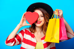 Woman with shopping bags and heart box Royalty Free Stock Photo