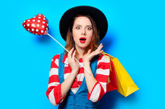 Woman with shopping bags and heart shape toy Stock Image