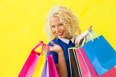 Woman with shopping bags in her hands Royalty Free Stock Photography