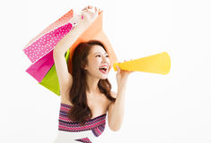 Woman with shopping bags and holding megaphone. Asian woman with shopping bags and holding megaphone stock photo