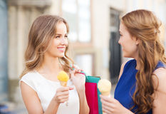 Woman with shopping bags and ice cream in city Stock Photography