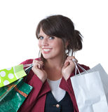 Woman with shopping bags; isolated. Young woman with shopping bags; isolated on a white background Royalty Free Stock Photos